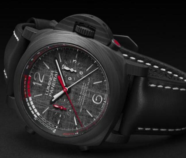 The red elements are striking on the black dial.